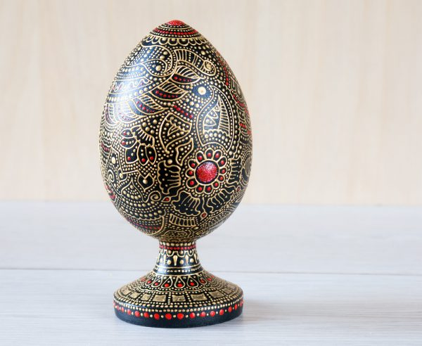 Wooden egg on a stand - gold